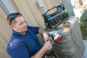 Air Conditioner Repair Man checking levels on commercial air conditioning unit